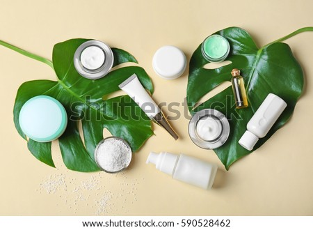 Natural cosmetics and leaves on light background Royalty-Free Stock Photo #590528462