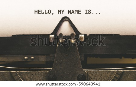 Hello, my Name is, Text on paper in Vintage type writer machine from 1920s closeup with paper Royalty-Free Stock Photo #590640941