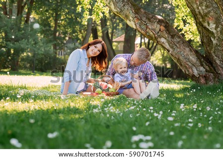 Family having a great time in the park. Father playing with son. #590701745