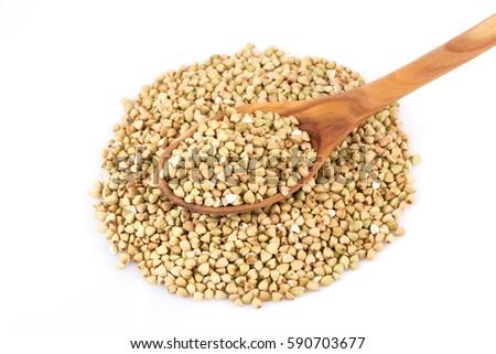 Pile of organic bio buckwheat raw in spoon on a white background #590703677