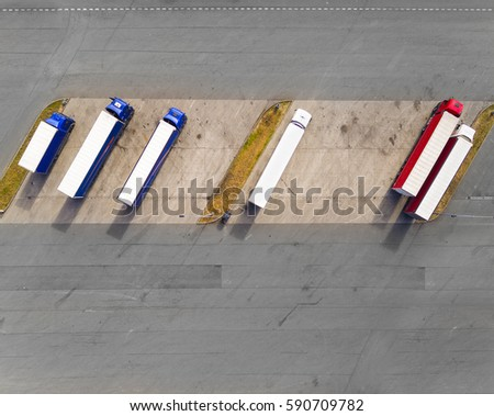 Aerial view of parking lot with trucks. Industrial background on transportation theme. #590709782