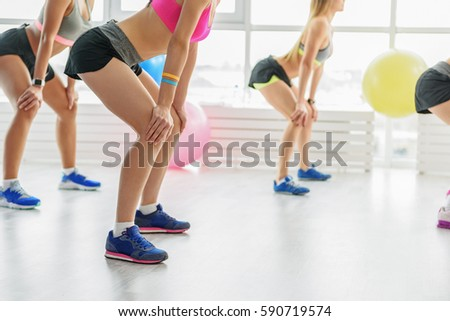 Sportive young women in light gym #590719574