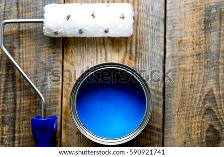 painting with  can of blue paint and roller top view #590921741