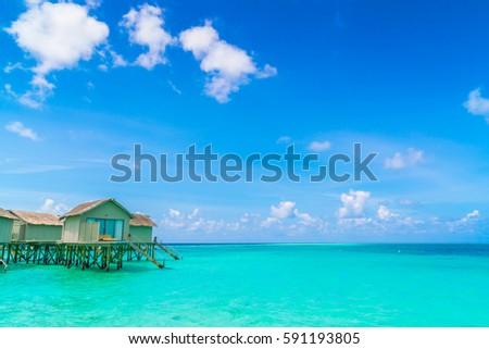 Beautiful water villas in tropical Maldives island #591193805