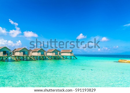 Beautiful water villas in tropical Maldives island #591193829