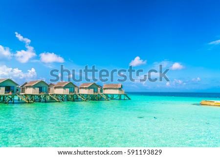 Beautiful water villas in tropical Maldives island #591193829