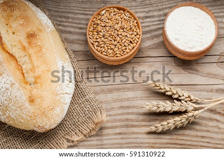 loaf of bread on wooden table. top view #591310922