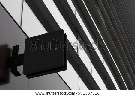 Horizontal side view of empty black signage on business skyscraper with modern architecture and glass windows