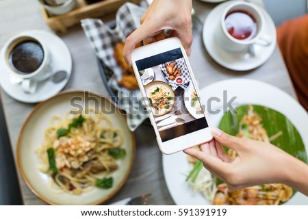 Cellphone taking photo on food from top view