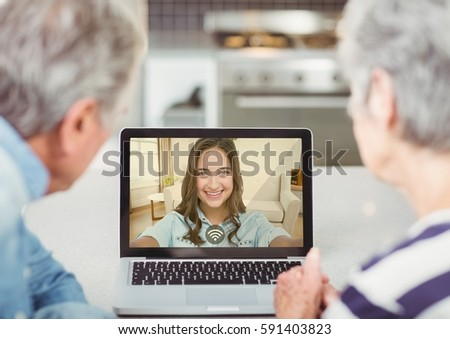 Senior couple having video call with daughter on laptop at home #591403823