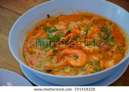 Tom Yum Kung,Spicy Shrimp Creamy in bowl on the wooden table ,  Thaifood, Thailand  #591418328