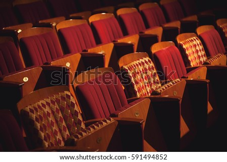 Closeup view on rows of theater or cinema seats.  #591494852