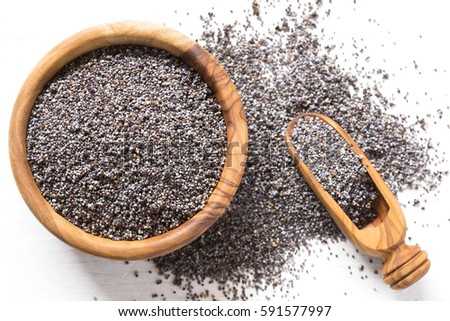Poppy seeds in a wooden bowl #591577997