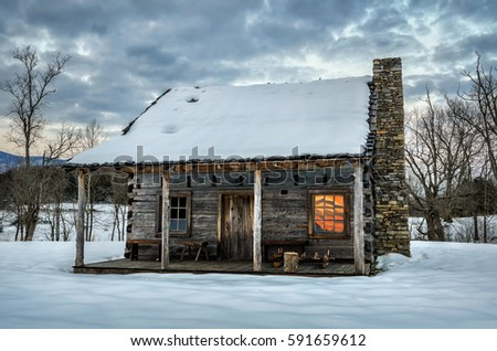 Fresh snow on old homestead