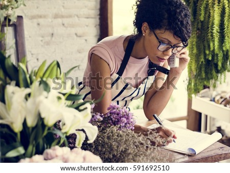 Business of flower shop with woman owner Royalty-Free Stock Photo #591692510
