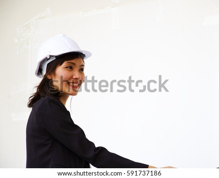 Business woman wears white safety hat on white background. #591737186