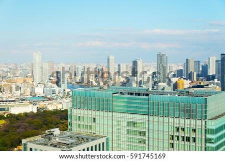 Tokyo City Scape Taken from Shinbashi, Tokyo, Japan - February 25, 2017: Including; The Tokyo Towers, Harumi Island Triton Square, Shiki Theatre, Shiki Theater, Shiodome Building,  Saint Luke's Tower. #591745169