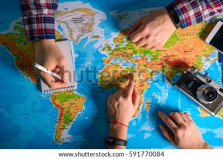hands point on map where to go travel planing vacation #591770084