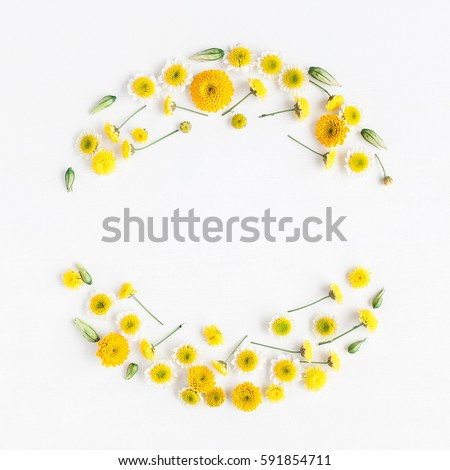 Flowers composition. Wreath made of various yellow flowers on white background. Easter, spring, summer concept.  Flat lay, top view, copy space