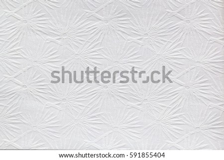 White embossed paper texture for background.  Sparkler pattern. Can be used for presentation, paper texture, and web templates with space for text. #591855404