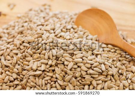 pile of raw sunflower seeds #591869270
