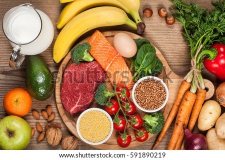 Balanced diet - healthy food on wooden table #591890219