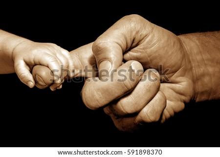 baby hand holding by adult #591898370