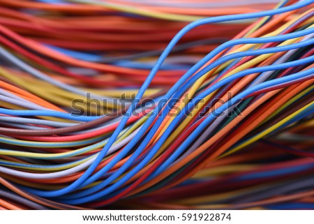 Closeup of cable and wire in computer network systems Royalty-Free Stock Photo #591922874