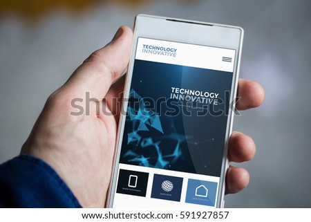 man hand holding innovative website smartphone. All screen graphics are made up. #591927857