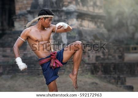 Martial arts of Muay Thai,Thai Boxing, Muay Thai. Royalty-Free Stock Photo #592172963