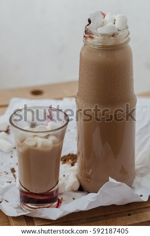 glass cup and jar of hot coffee drink #592187405