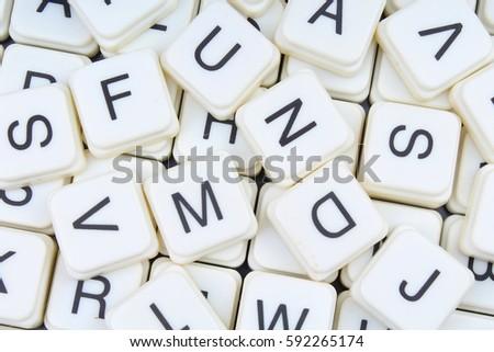 Letters as background.3D block letters texture.Letter collection pattern. Alphabets crosswords background.