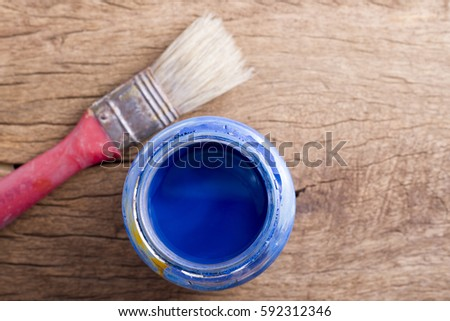 Old paintbrushes on wooden background  #592312346