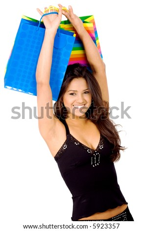 girl happy with her shopping lifting the bags up - isolated over a white background #5923357