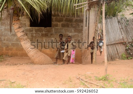 LOME, TOGO - Jan 9, 2017: Unidentified Togolese children walk on the street. Togo children suffer of poverty due to the bad economy #592426052