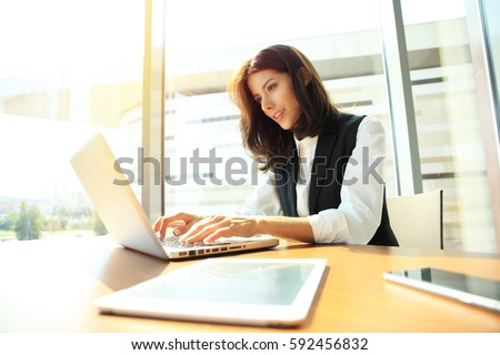 Hipster Girl use Laptop huge Loft Studio.Student Researching Process Work.Young Business Woman Working Creative Startup modern Office.Analyze market stock,new strategy. Horizontal Royalty-Free Stock Photo #592456832