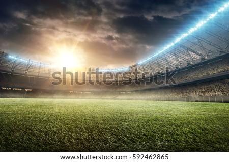 soccer stadium with green grass and illumination Royalty-Free Stock Photo #592462865