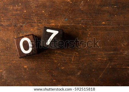 Cube numbers on old wooden table with copy space, 07 #592515818