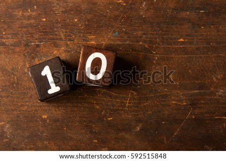 Cube numbers on old wooden table with copy space, 10 #592515848