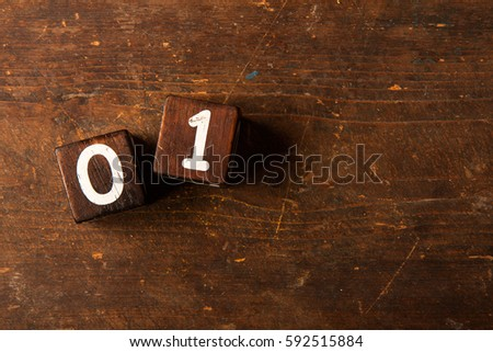 Cube numbers on old wooden table with copy space, 01 #592515884