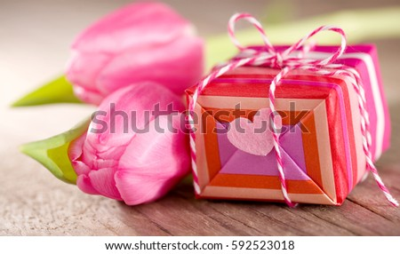 Cute gift with heart and tulips on wood #592523018