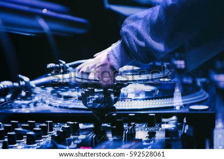 MOSCOW - 7 AUGUST,2016: Party dj audio equipment on scene in night club.Bright stage concert lighting.Disc jockey play music show,mix tracks.Entertainment event in Space nightclub.Double exposure #592528061