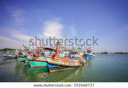 Editorial use only; fishing boats and blue sky, at Chaam, Phetchaburi, Thailand, on January 2nd, 2017. #592668737