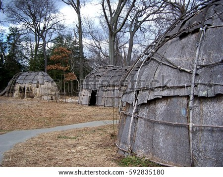 Bark-covered wigwams at a reconstructed Native American village in Maryland, home to the Nanticoke, Shawnee, Piscataway, Lenape, Tuscarora, and Susquehannock nations. #592835180