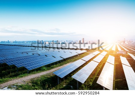 solar panels with the sunny sky. Blue solar panels. background of photovoltaic modules for renewable energy. Royalty-Free Stock Photo #592950284