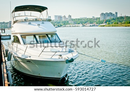 the yacht at the mooring on the river bank, the yacht on the mooring overlooking the city, the river yacht #593014727