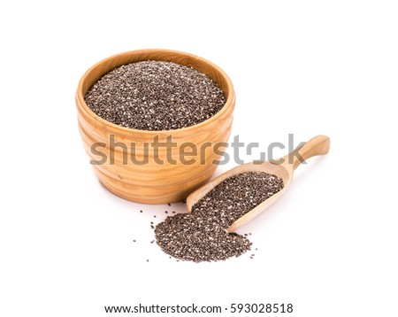 Wooden bowl with chia seeds and a spoon to the right of it on white background #593028518