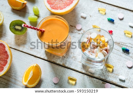 Healthy lifestyle and diet concept. Fruit, pills and vitamin supplements, flat lay. New year's resolution, fresh start, losing weight concept. #593150219