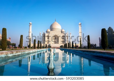 Agra, Uttar Pradesh, India - The morning view of Taj Mahal monument reflecting in water of the pool, Agra, India Royalty-Free Stock Photo #593203085