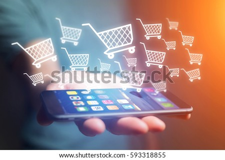 View of Virtual trolley going out of a smartphone - shopping online concept #593318855
